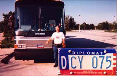 Pointing Man pointing at Department of State Diplomatic License Plate on bus at Splendid China at 1730 hours October 12, 1996.
