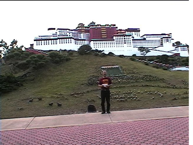 Reading statement in front of Potala Palace exhibit at Florida Splendid China on December 15, 2001