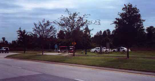 The watchful Sheriffs (and two FSC security vehicles) across the street from the Main Gate of Florida Splendid China during 10/13/96 demonstration.