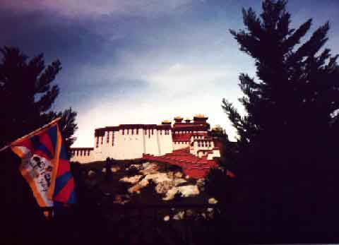 A view of the Tibetan National flag against a backdrop of the Potala Palace exhibit at the Florida Splendid China Theme park